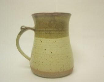 Wheel thrown Stoneware mug. Iron red and Buttermilk glazed