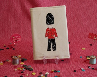 Free motion machine embroidered and appliqué embellished notebook cover depicting Soldier by Lotties Little Treasures