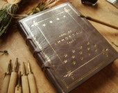 Book of Immortal Tales - A large handmade leather journal bound in grey leather and tooled with gold foil