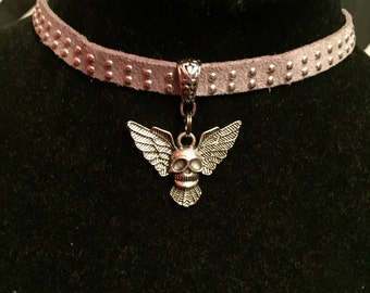 Tan studded choker with winged skull Pendant