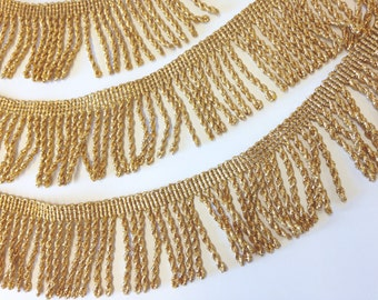 2 inch Gold Metallic Lurex Fringe, offered in 3 lots of 10 yards each. Made in the UK.