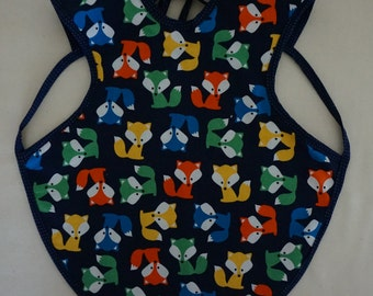 Fox child's bib that covers a large part of their body.  Reversible with cotton on one side and flannel on the other.