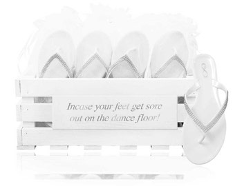 personalised crate containing 30 pairs of diamanté jelly sandals.