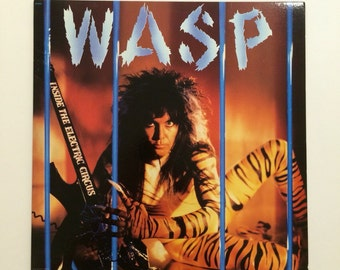 W.A.S.P. - Inside The Electric Circus  vinyl record album LP