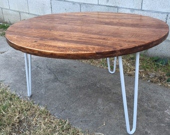 Antique walnut circular reasoning  with white legs