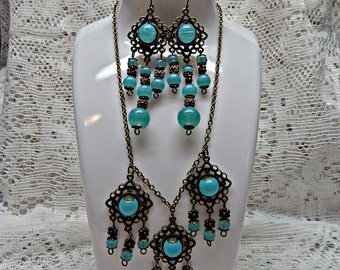 Antique bronze setting, with Blue Jayde style beads