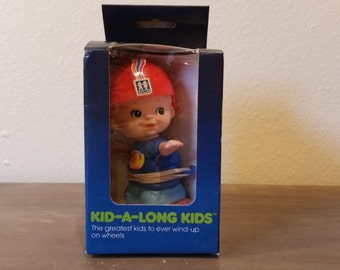 Kid-A-Long-Kids Boy on Skateboard by TOMY Vintage 1970's