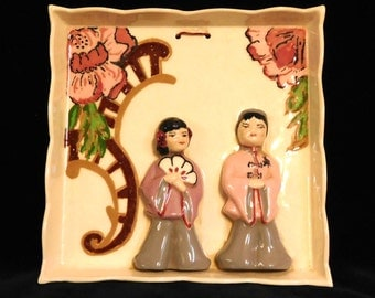 Adorable plaque from the 1940's--Chinese couple in arbor