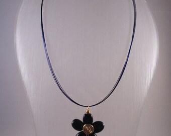 Gemstone pendant.  Lapis Lazuli flower pendant