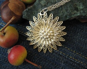 Silver filagree flower pendant