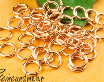 25 x jump rings 8 x 1.2 rose gold plated art. 912