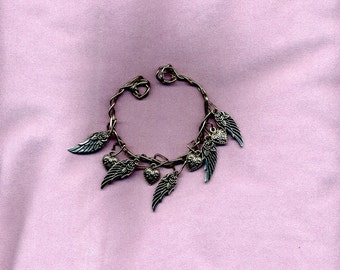 Bracelet.  Twisted wire with angle wings and heart charms