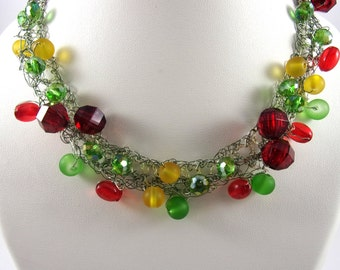 Silvery nekclace  with red , green , yellow pearls , silvery wire .