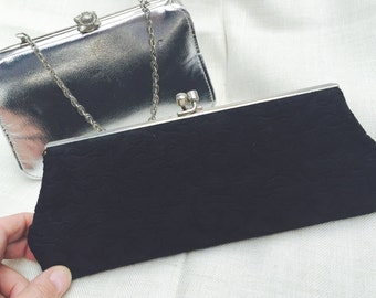 2 super cute Vintage 1950's purses. One silver bag with chain handle and one black clutch.