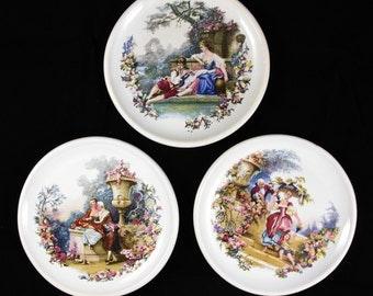 Set of 3 Vintage Victorian Style Ceramic Decorative Plates with Pastoral Scenes.