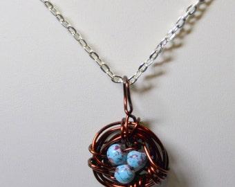 New life brown bird's nest pendant