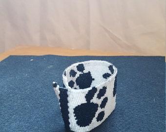 Color bracelet black and white prints paws