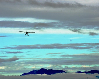 Alaskan Bush pilot above the clouds
