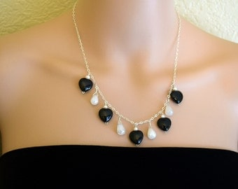 Black Onyx and Pearl Chalcedony necklace. Black Onyx and Faceted Pearl Chalcedony beads. Sterling Silver necklace. Jewelry under 50 dollars