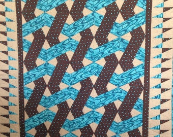 Brown and turquoise and tan weave look quilt