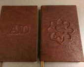 Special order!  Two custom leather notebooks with raised emboss details