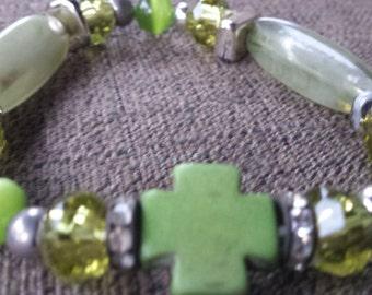 Green cross and rhinestone beaded bracelet