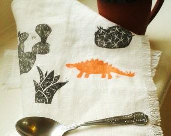 Stegosaurus and Cacti Hand-Printed 100% Linen Fringed Tea Towel Black and Orange/Olive Green on White