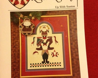 Up with Santas.    Heartstrings cross stitch pattern