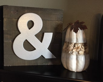 "Rustic wood pallet silver ampersand ""and"" sign."