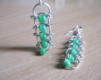 Design earrings rings and Green Pearl