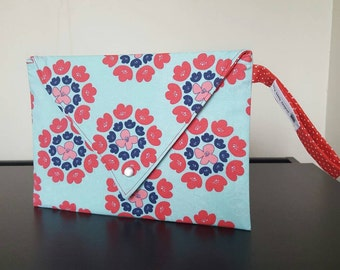 Envelope clutch. Lined, snap closure, wristlet handle. Multiple uses.