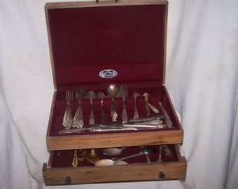 Vintage silver plated silverware in a vintage wooden box