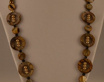 """22"""" Necklace featureing neutral colors with black accents"""