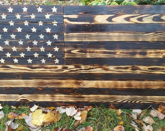 United States Flag. Wood US flag made from reclaimed wood. All star are hand chiseled. Free shipping.