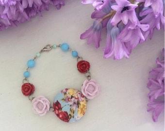 Mauve, red and blue bracelet