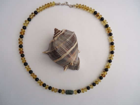 Mexican amber, Guatemalan green jadeite and black onyx necklace. Sterling silver beads and clasp. Handmade.
