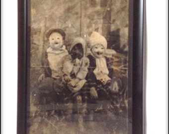 Aged reproduction creepy Victorian children print in frame.