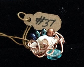 copper wire ring with shell and glass beads