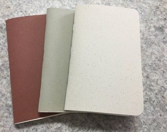 Set of three pocket notebooks