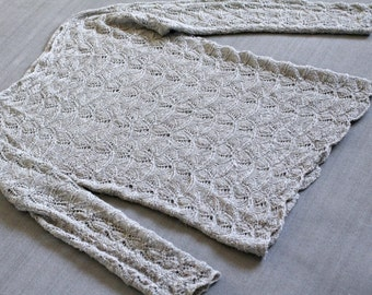 Soft hand-knitted lace sweater.