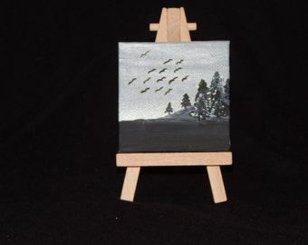 3x3 black and white painting on easel