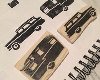 Hand carved rubber vintage car and camper