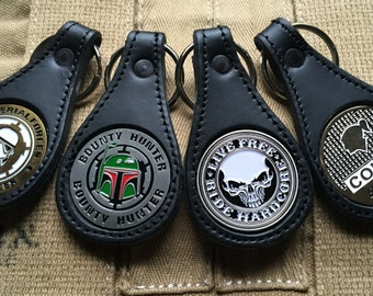 Handmade leather keychain with various coin emblems
