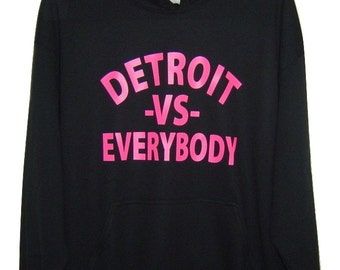 Detroit -vs- everybody  neon pink logo on Black pull over hoodie all sizes.