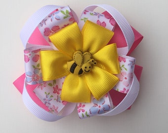 A double pink and white bow