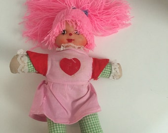 Yarn haired doll. Plaid pants green red pink