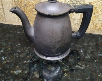 Vintage metal old teapot very small