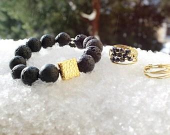 Black lava stone bracelet with gold inlay