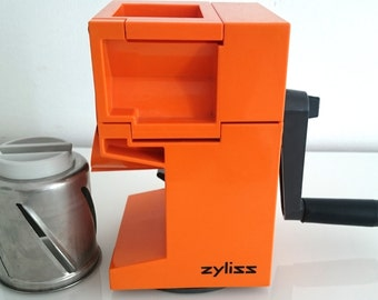 Vintage Zyliss kitchen grater stand grater, orange, with crank and suction cup. 1970s. kitchen grater/grinder, orange, with suction cup and crank.