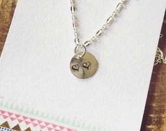 Hand stamped hearts necklace